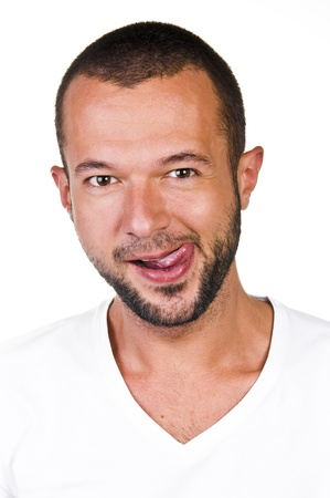 Portrait of a young man with his tongue, white background Stock Photo
