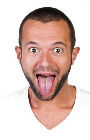 Portrait of a young man with his tongue, white background photo