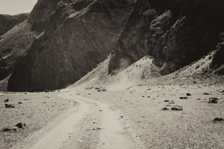 Black-and-white photo under the antiquity on which the dirt road Altai, Altai Republic, Russia