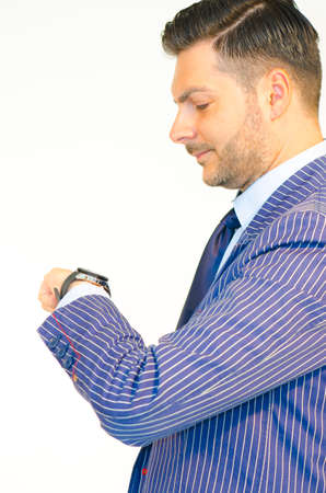 boy body: Business man looking at his watch islolated on white background