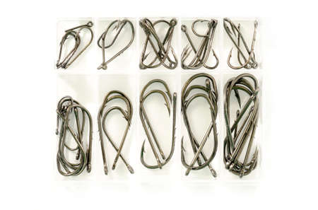 sinkers: Different sizes of fishing hooks in plastic box isolated on white background