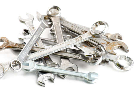 disordered: Many wrenches disordered, some of them rusted, isolated on white Stock Photo