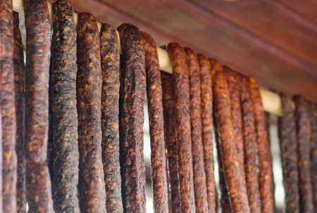 season specific: Romanian traditional sausages hanging on a stick