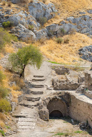 broken hill: Ruins of a path with stone stairs and old stone wall in mountain