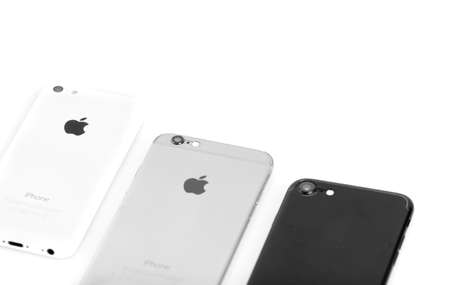 3 generations: BRASOV, ROMANIA - 27 November 2016: 3 generations of Apple: iPhone 5, iPhone 6, iPhone 7 in row, back details and cameras isolated on white background