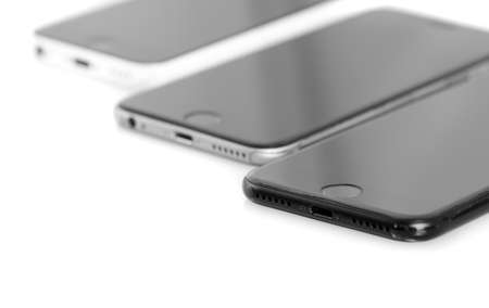 3 generations: BRASOV, ROMANIA - 27 November 2016: 3 generations of Apple: iPhone 5, iPhone 6, iPhone 7 in row, isolated on white background Editorial
