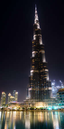 5 SEPTEMBER 2017, DUBAI, UAE -  Vertical panorama of Burj Khalifa, the talles building in the world 829m at night near lake with reflexion Editorial