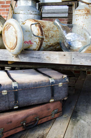 Vintage - Arrangement of ancient objects - Suitcases, metal barrel and other old stuff  photo