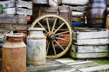 wheel barrel: Arrangement of old stuff - Metal milk barrel, wooden boxes, fruit cases and other old stuff - Vintage - HDR