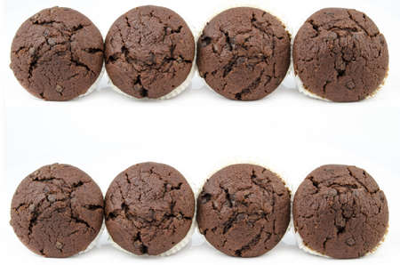 Group of chocolate muffins isolated - two rows photo