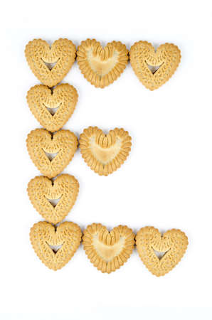 Bakery - The letter  E  written from biscuits - Isolated on white - First year of school photo