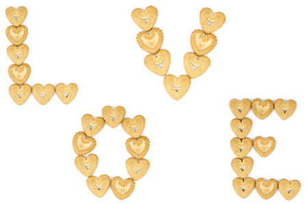 Bakery - Alphabetic letters from heart shaped biscuits - Isolated on white photo