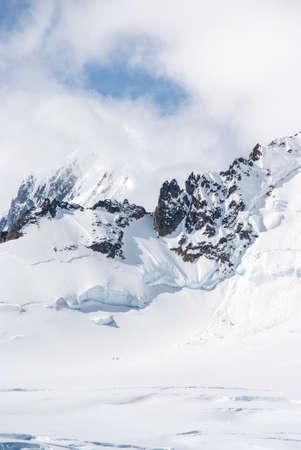 antarctic peninsula: Antarctica - Snow And Clouds -  Antarctic Peninsula - Palmer Archipelago - Neumayer Channel - Global Warming - Fairytale Landscape Stock Photo