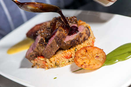 Fine Dining - Roasted Lamb Steak With Couscous, Baked Prickly Pear And Spiced Lamb Jus