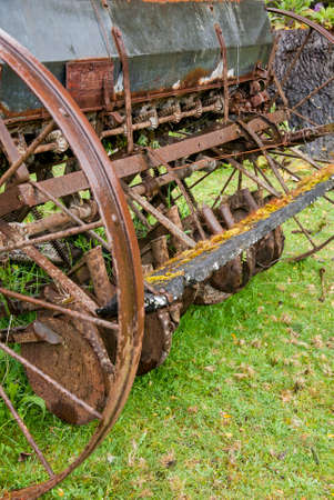 antiquated: Antiquated abandoned agricultural harrower antique farm equipment