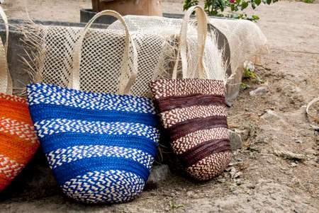 Women fashion accessories, Various items of crocheted bucket-style handbags, Wayuu handcrafted mochilas woolen bags, Ecuador - street market Imagens