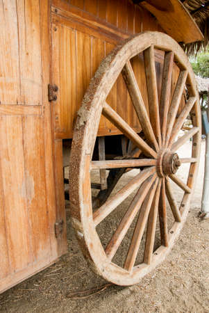 spoke: Wagon wheel - old wagon wheel - Manta - Ecuador Stock Photo