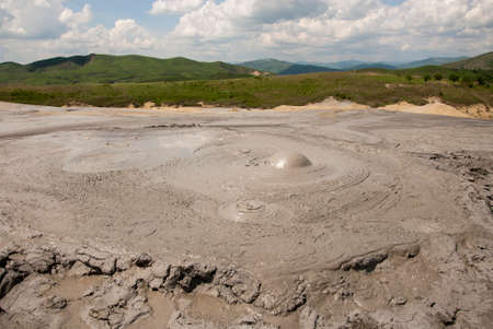 making earth: Romania, Buzau, Berca - Active Mud Volcanoes, Muddy Volcanoes Reservation in Mountains, View Landmark for Tourists, Landscape (unique geological phenomenon in Europe where the earth gas reaches the surface through hills making small Mud volcanoes)