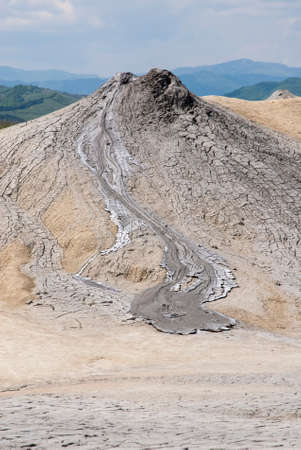 Romania, Buzau, Berca - Active Mud Volcanoes, Muddy Volcanoes Reservation in Mountains, View Landmark for Tourists, Landscape (unique geological phenomenon in Europe where the earth gas reaches the surface through hills making small Mud volcanoes)