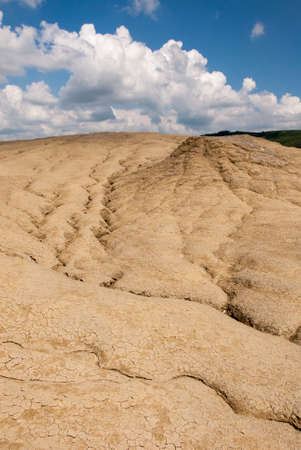 reaches: Romania, Buzau, Berca - Active Mud Volcanoes, Muddy Volcanoes Reservation in Mountains, View Landmark for Tourists, Landscape (unique geological phenomenon in Europe where the earth gas reaches the surface through hills making small Mud volcanoes)