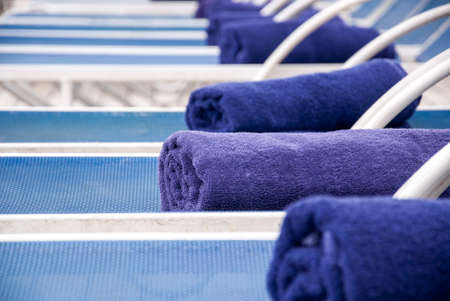 lounge chairs: Towels Placed On Lounge Chairs On Deck Of Cruise Ship