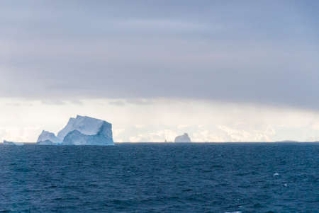 palmer: Antarctica in a cloudy day- Antarctic Peninsula - Palmer Archipelago - Neumayer Channel - Global warming - Fairytale landscape