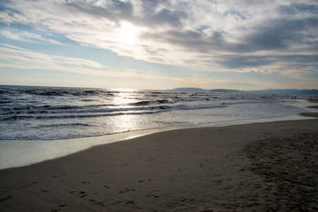 Beautiful summer sunset on the beach at Italy. Mediterranean sea - Province of Lucca - Provincia di Lucca - Italy