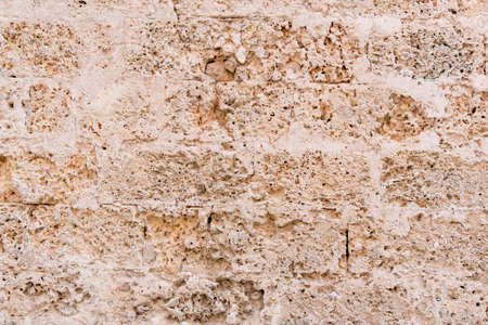 Architectural background pattern and textures of a natural stone wall bonded with mortar - Havana - Cuba