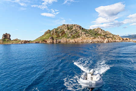 Italy, Sardinia, Nuoro province, National Park of the Bay of Orosei and Gennargentu, sailing along the coast cliffs - 20 May 2019