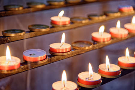 Burning candles inside Winchester Cathedral, Hampshire, England, United Kingdom. Photo taken on 6th of May 2019 写真素材