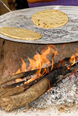 Making tortillas over a wood fire in El Fuerte, Sierra Madre Occidental, Sinaloa State - Mexico
