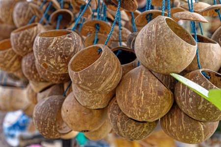 Coconut fruits handcraft in a street market in Bangkok - Thailand 写真素材