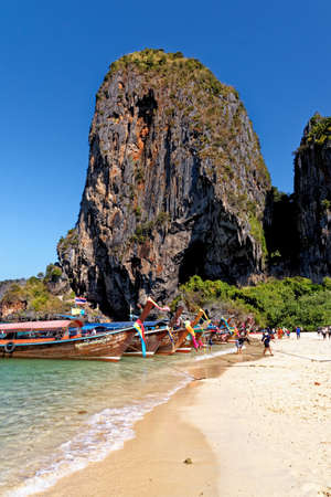 Longtail boats on Phra Nang beach, Railay, Krabi province, Thailand: longtail boats and Princess Cave - Travel destination - 25th of January 2020