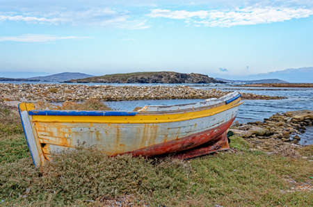 Dilapidated Greek boat in the Aegean Sea on the famous island of Delos - Greece