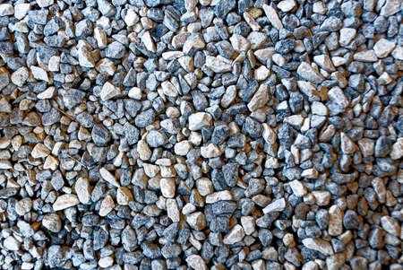 Close-up of natural stone background . Abstract full frame textured background - Natural abstract texture - different colorful pebbles background