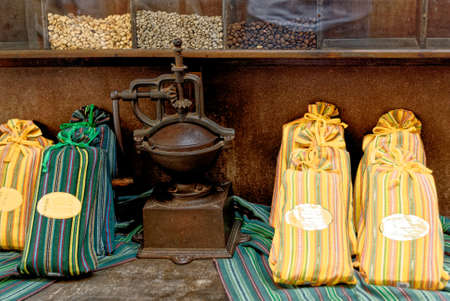 Shop desplay with old coffee grinder, coffee beans and coffee bags for sale in coffee shop - Antigua - Guatemala. 24th of March 2011