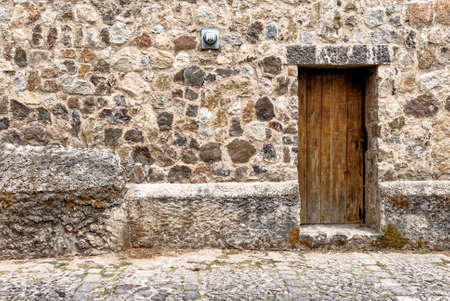 Spanish Colonial Style - Wooden Door And Stone Wall In Antigua Guatemala - 24th of March 2011