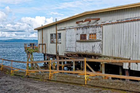 Old warehouse over Columbia River Bay - Astoria, Oregon - United States Of America - 16th of September 2013