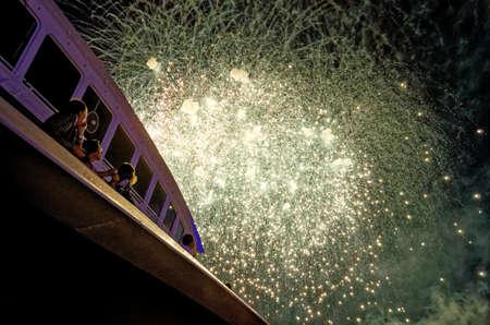 Fireworks Extravaganza over Hamburg Harbor - Happy people watching fireworks - Hamburg, Germany 18th of August 2012