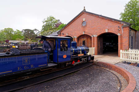 Railway turntable for steam engines - Miniature steam train at Exbury Gardens - England UK - 20th of May 2021