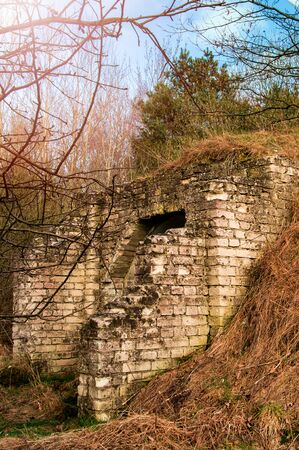 demarcation: Outside detailed view of loophole of old military bunker