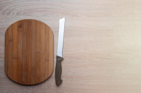 breadboard: Wooden breadboard with knife