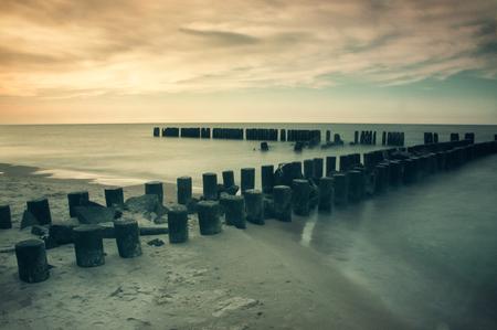 breakwaters: Seascape with breakwaters. vintege landscape polish sea shore