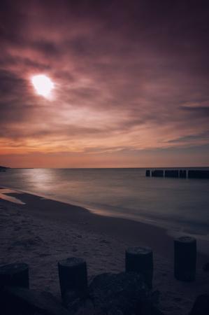 breakwaters: Seascape with breakwaters. vintege landscape polish sea shore. Scary blurry sky