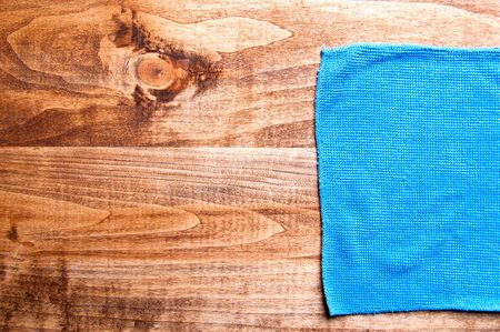 microfiber cloth: Blue microfiber cloth on a wooden background