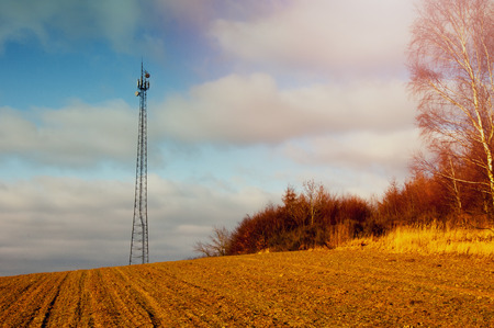 cell phones: The image of phone tower in a small village