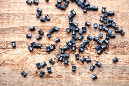 plumbum: pellet from an air gun, wooden table