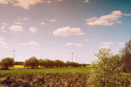 pollution free: Wind turbine in rape field Stock Photo