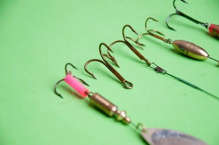 backgound: fishing hooks on a green backgound. Stock Photo