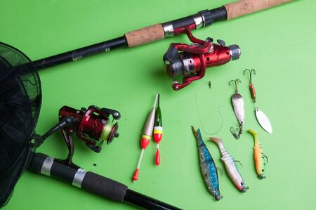 Fishing equipment on a green background.